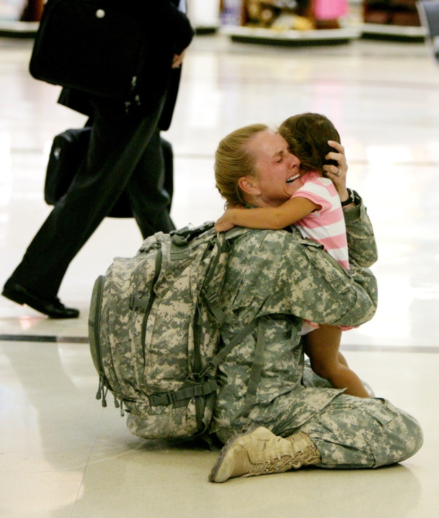 Terri Gurrola is reunited with her daughter after serving in Iraq for 7 months. [2007]